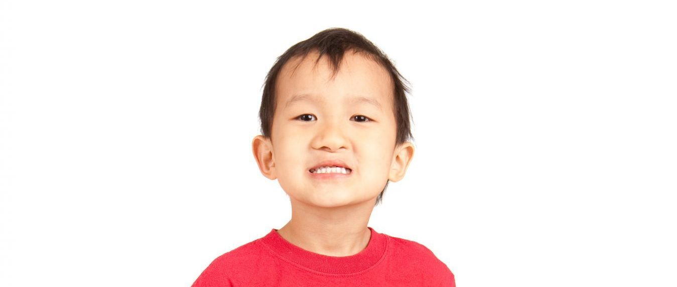 Asian preschooler holding a book. Please view these along with other