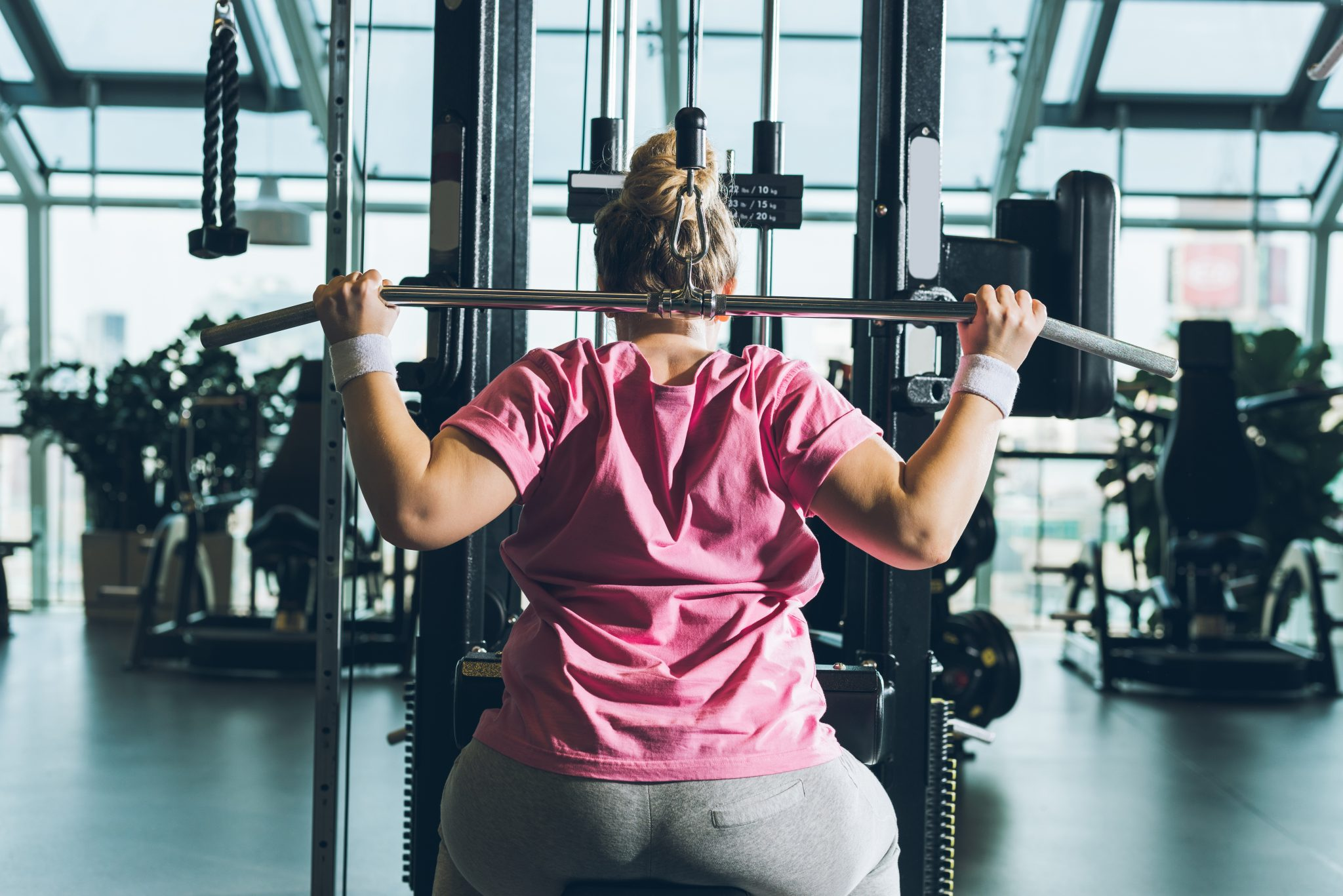 strong woman working out on training apparatus