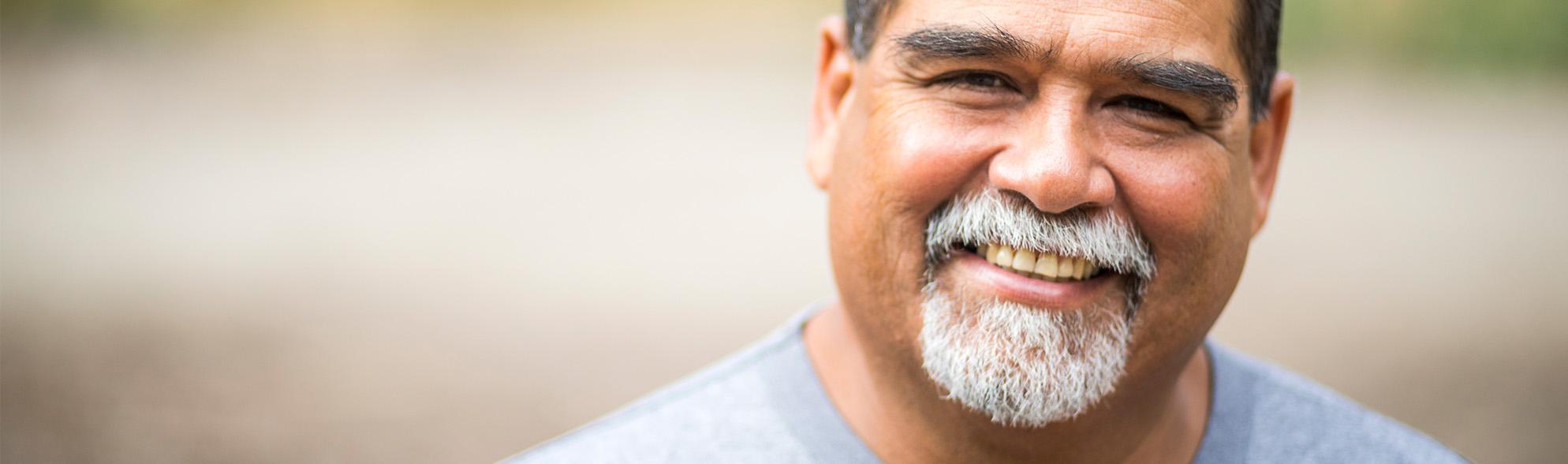 Smiling older gentleman of colour